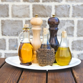 Set of olive oils,salt and pepper on a restaurant table